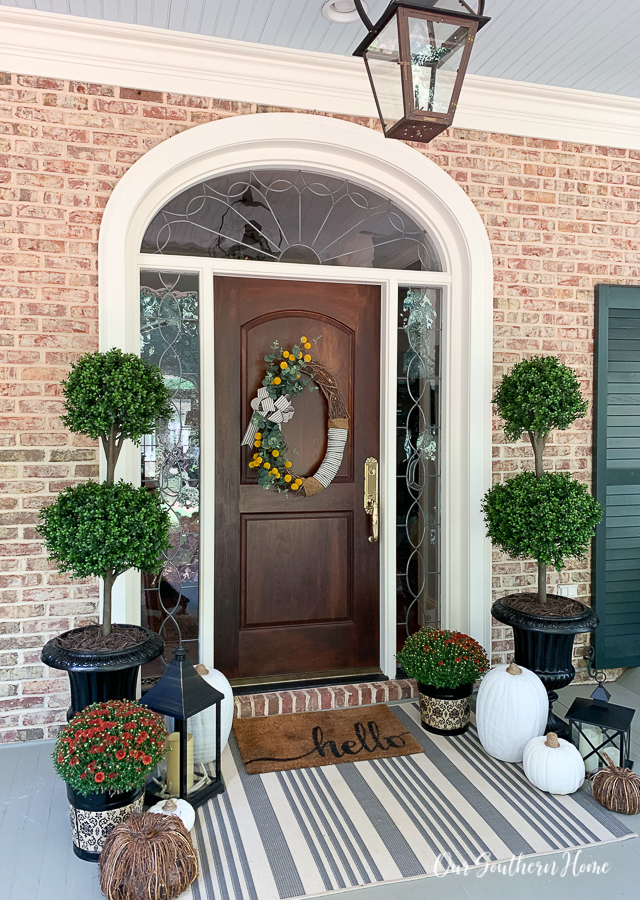fall front porch with pumpkins