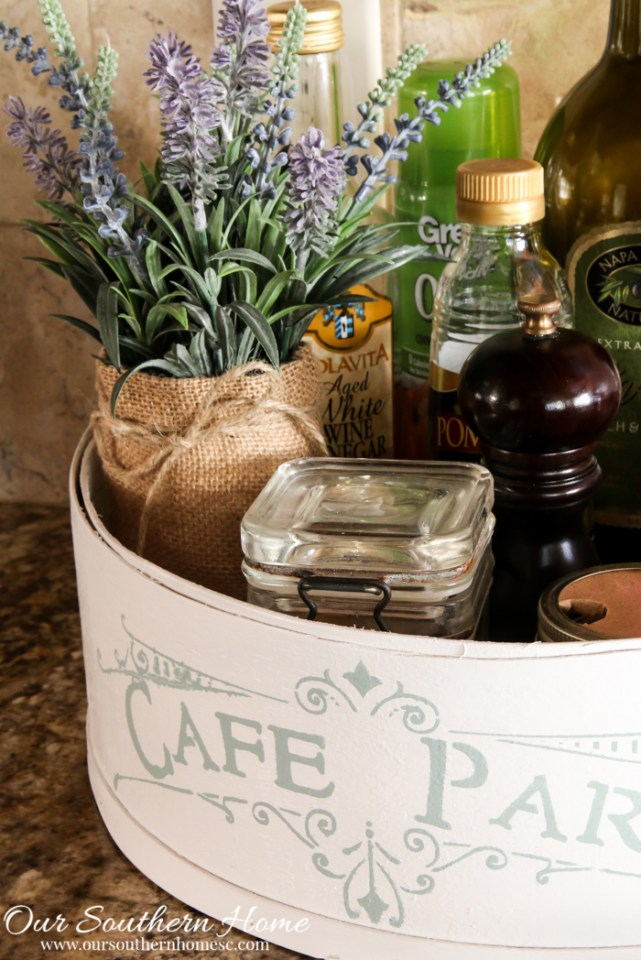 Hoop cheese box is transformed into a French Country farmhouse styled kitchen caddy.