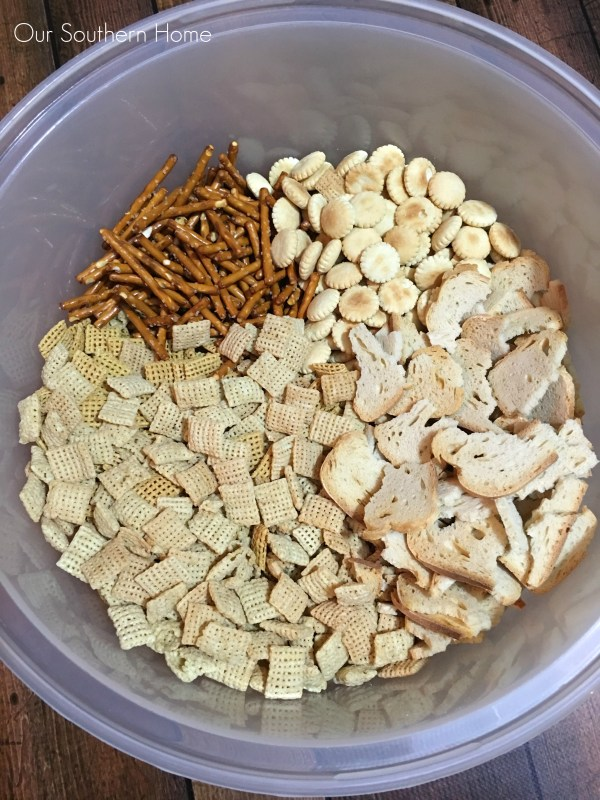 Combine your Chex cereal, melba toast, oyster crackers and pretzels via Our Southern Home for your Chex Party Mix recipe #ad