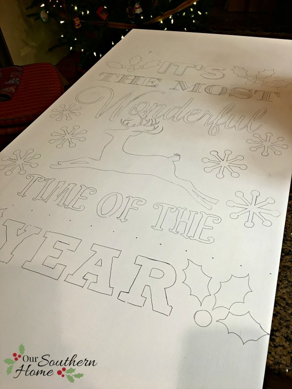 It's the most wonderful time of the year vintage look hand-painted DIY Christmas sign by Our Southern Home. This is much easier that you think! You've got to check it out! #homeforchristmas