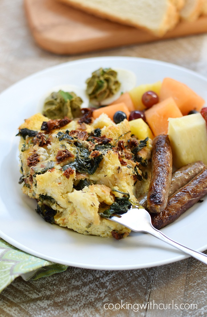 Sourdough Breakfast Strata with sun-dried tomatoes, spinach and fontina cheese is the perfect way to start the day | cookingwithcurls.com #Switch2Sourdough #ad