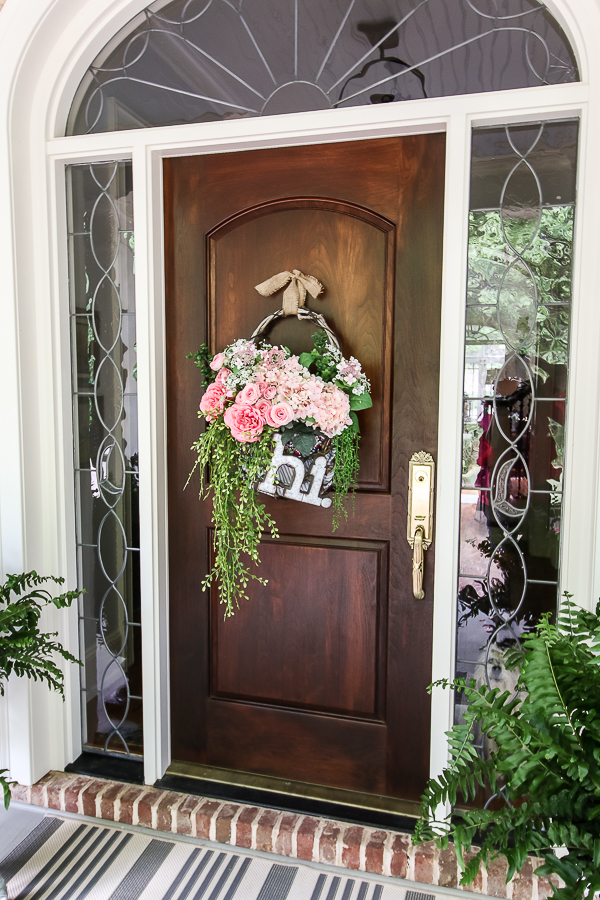 Cottage farmhouse style basket wreath is this month's thrift store makeover! Many ideas brought to you each month from the team! #thriftstore #makeover #wreath #basketwreath #frontdoor