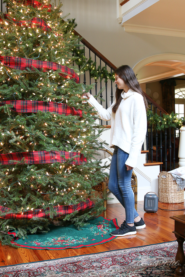 woman by christmas tree