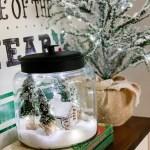 snowy cabin scene in a jar