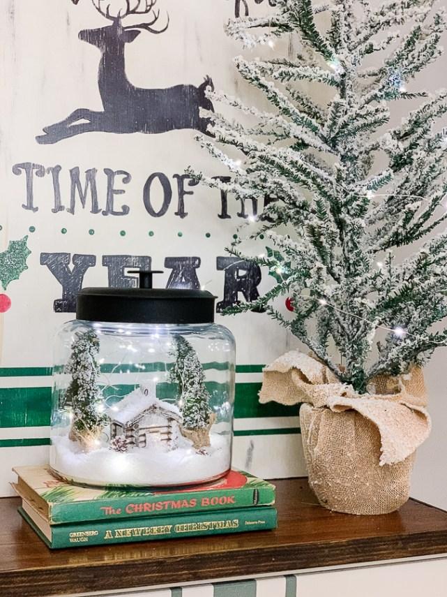 snowy jar scene in a christmas vignette