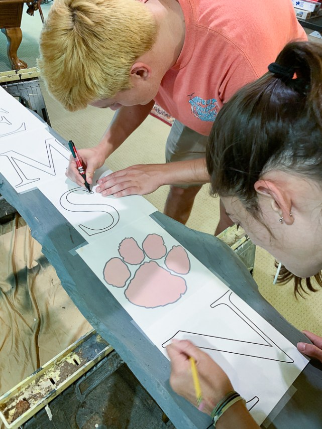 kids working on painted sign