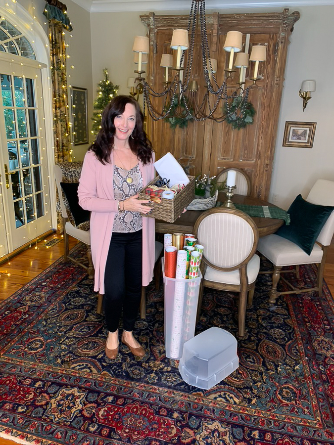 woman holding gift wrapping supplies