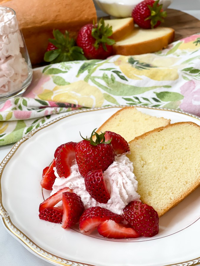 whipped cream on cake with strawberries