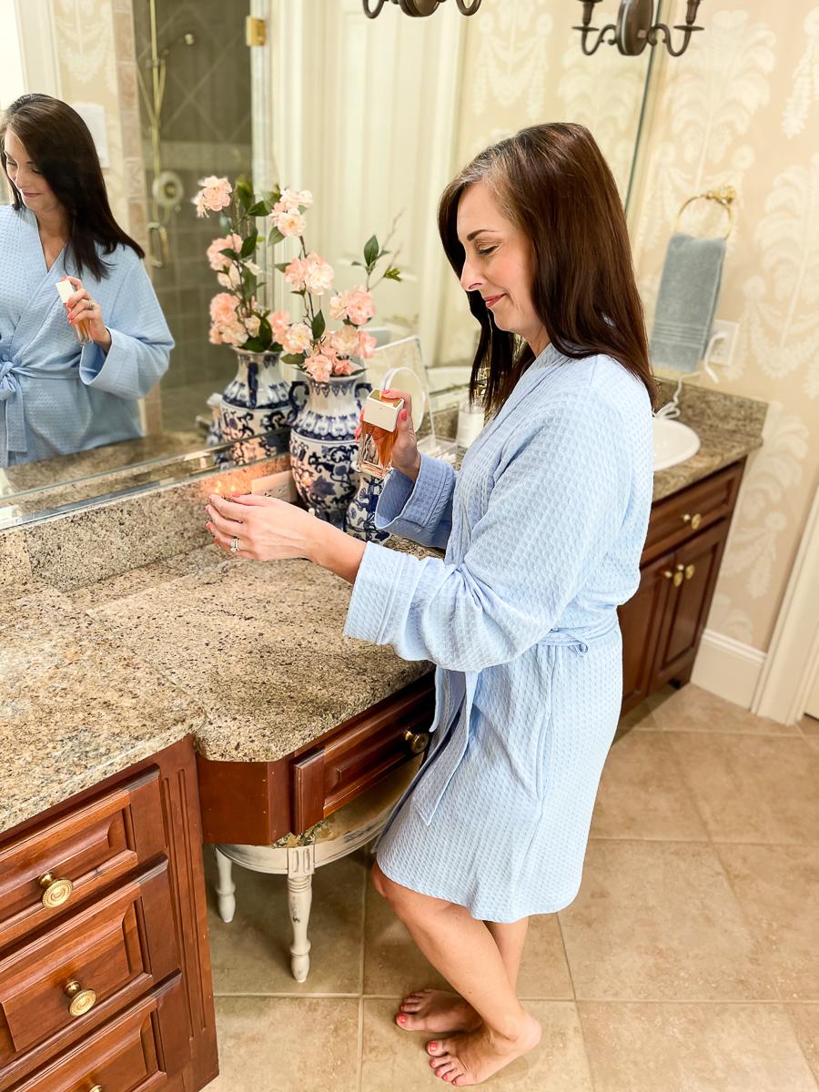 woman in blue bath robe