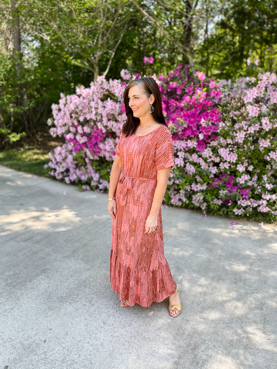 woman in long coral dress for summer