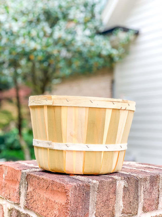 apple basket on a brick wall