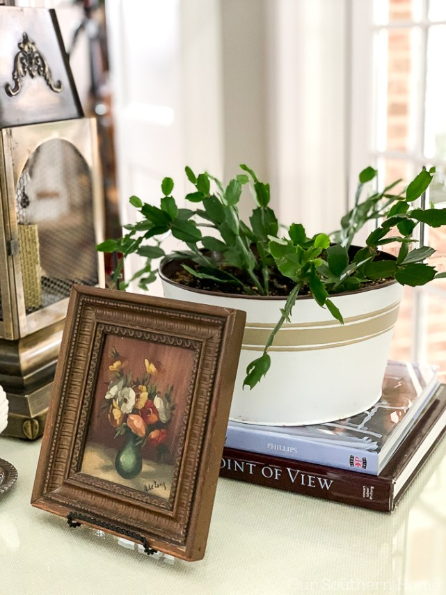 vignette with books and a plant