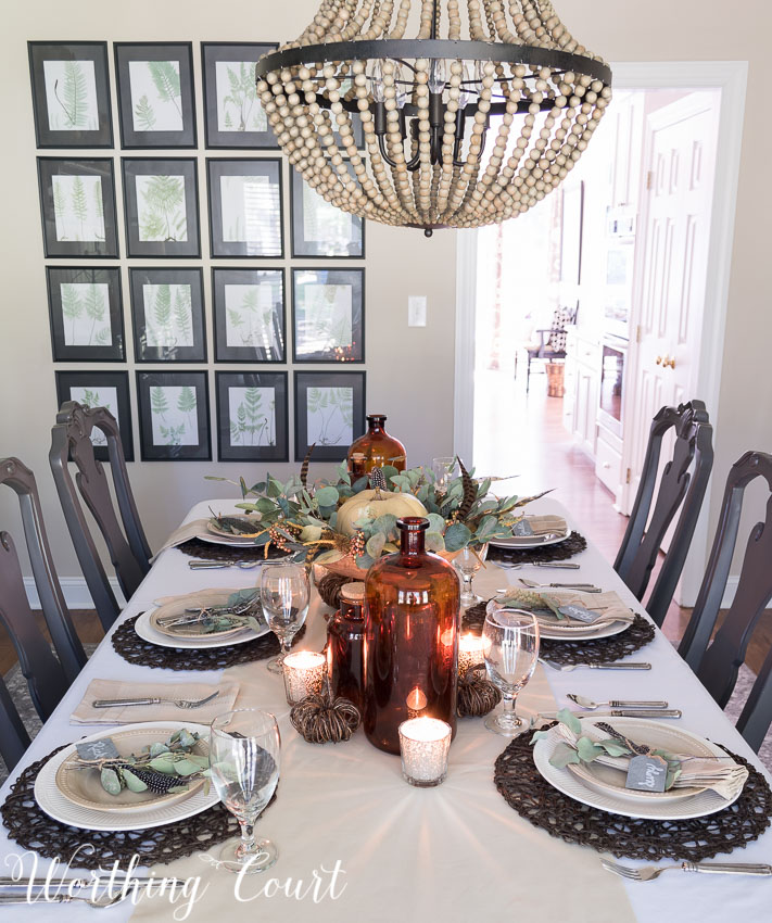 Mercury glass candle holders add a bit of sparkle to this Thanksgiving table || Worthing Court
