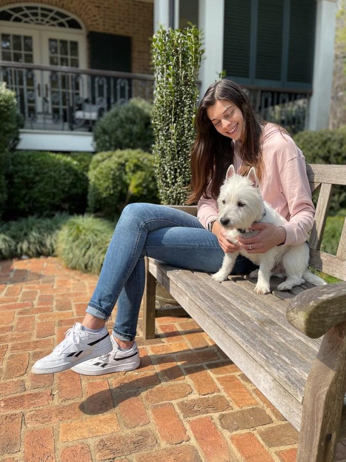 dog and girl on bench