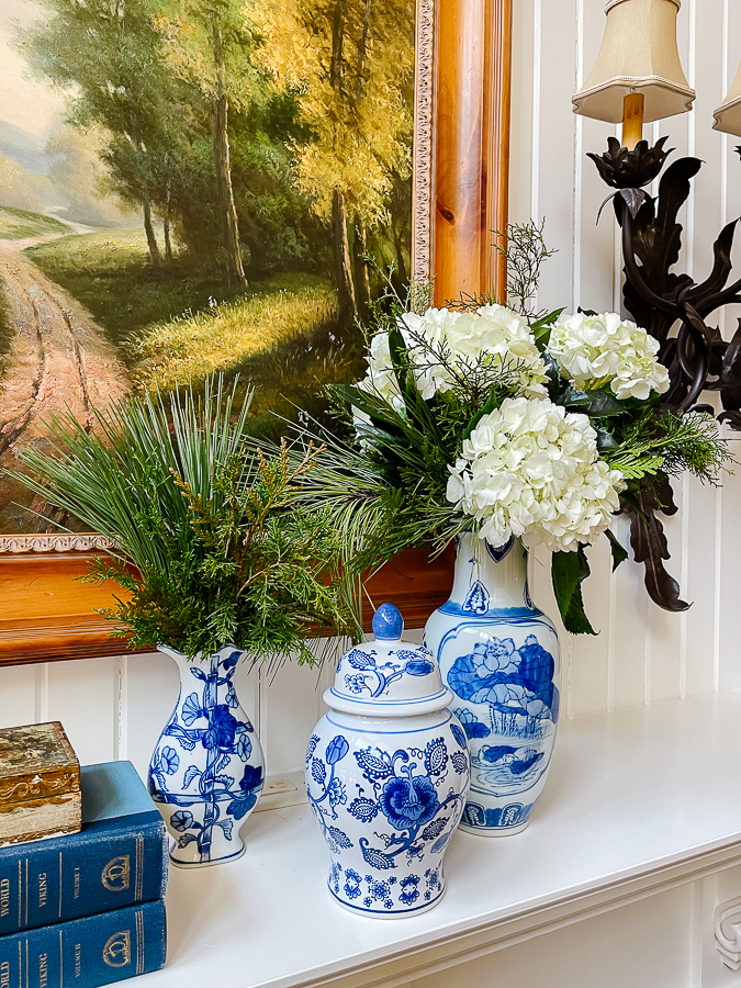 winter floral arrangements in blue and white vases