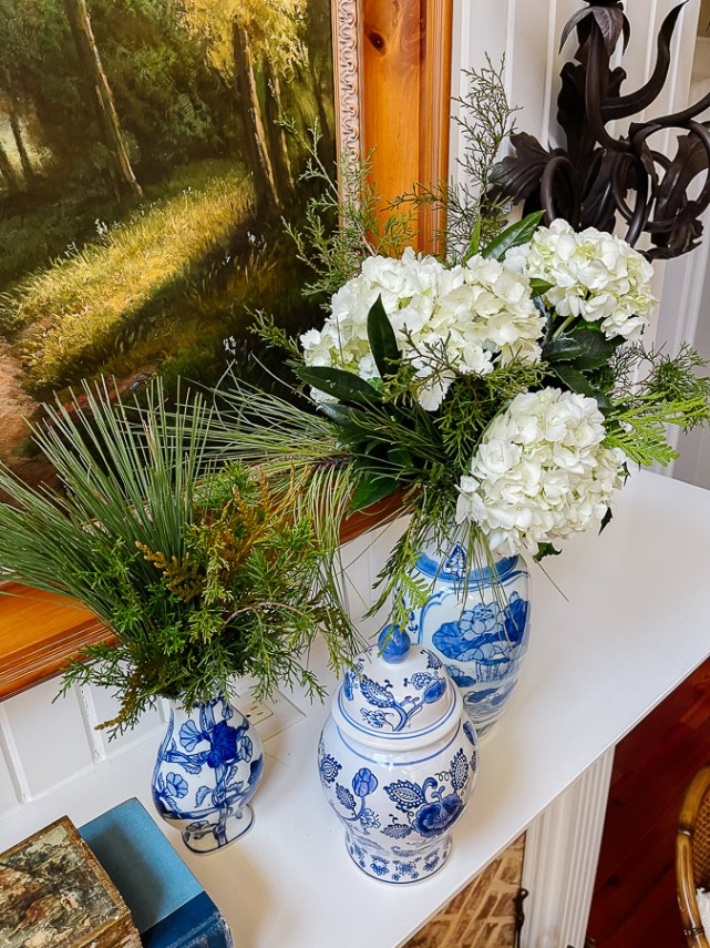 winter floral arrangement with blue and white porcelain on mantel