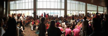 Pink Meno hymn sing on Saturday, July 4, 2015 outside the delegate assembly at the Mennonite Convention in Kansas City. It was the largest ever hymn sing with well over 300 people joining in. Panorama photo by Luke Yoder