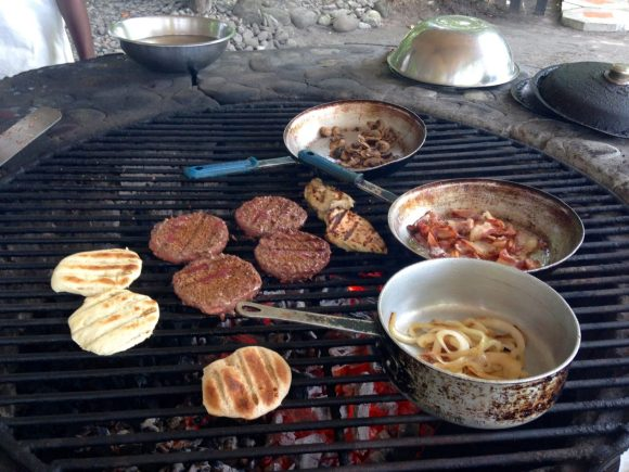 grilling burgers on the beach