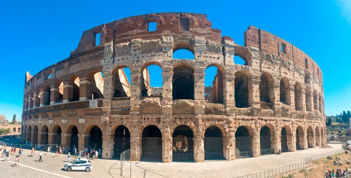 A panorama photo of theColosseum during a bright summer day.