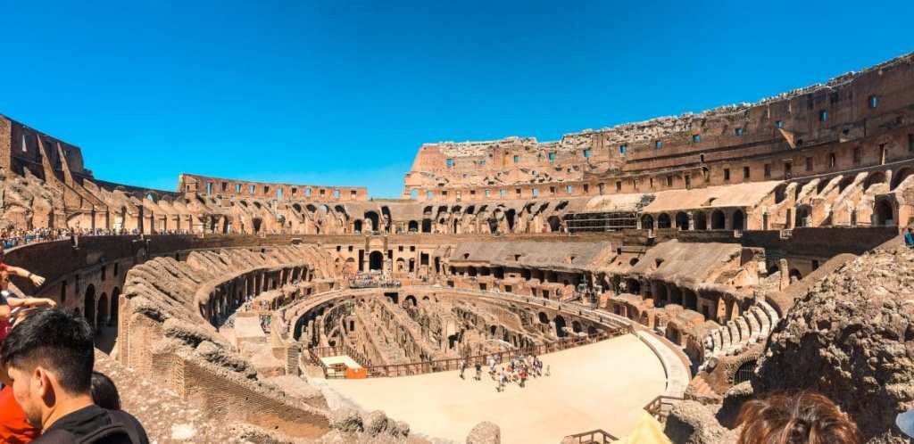 A spectacular panorama photo inside the Colosseum showing the amazing architecture of the amphitheater. A MUST