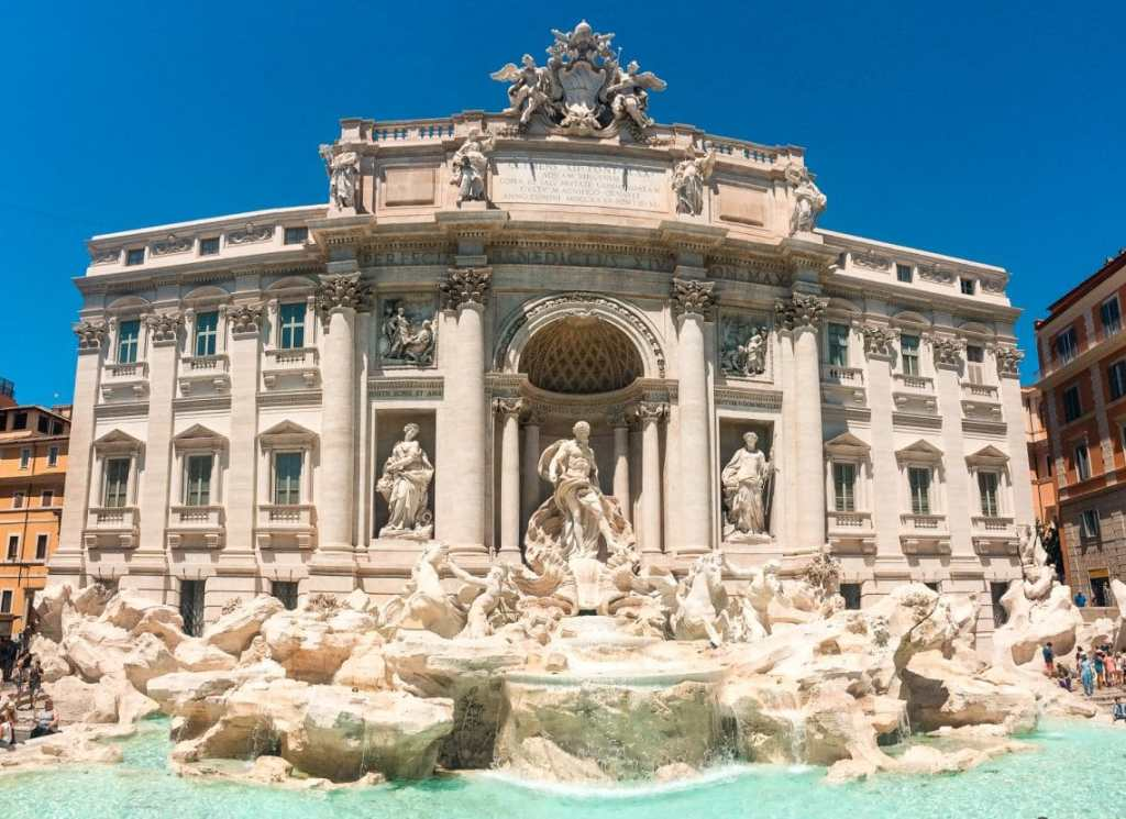A bright panorama photo of the Trevi Fountain in Rome - a must see during your 2 days in Rome itinerary.