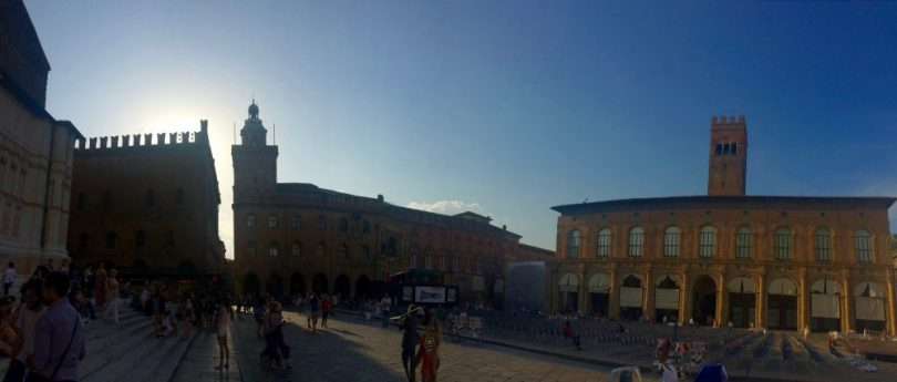 Watching the sunset in Piazza Maggiore during our layover in Bologna, Italy