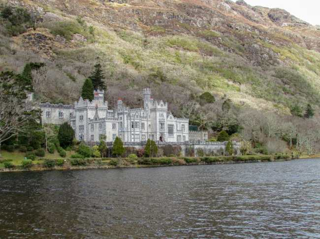 Kylemore Abbey, also known as Kylemore Castle is one of the most beautiful and iconic castles in Ireland. It sits along a long in Connemara National Park.