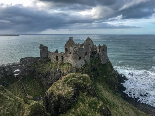 Dunluce Castle sits dramatically along the coast of Northern Ireland. If this castle looks familiar to Game of Thrones fans, it is because it's the castle used to represent the house of Greyjoy. Truly an amazing castle to see in Ireland.