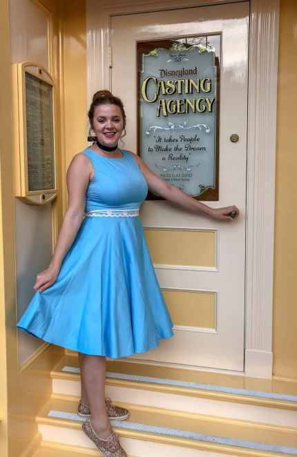 Adults playing dress up at Disneyland by Disneybounding! Adults can wear stylish every day clothes inspired by a Disney character. Here is an example for Disneybounding as Cinderella.