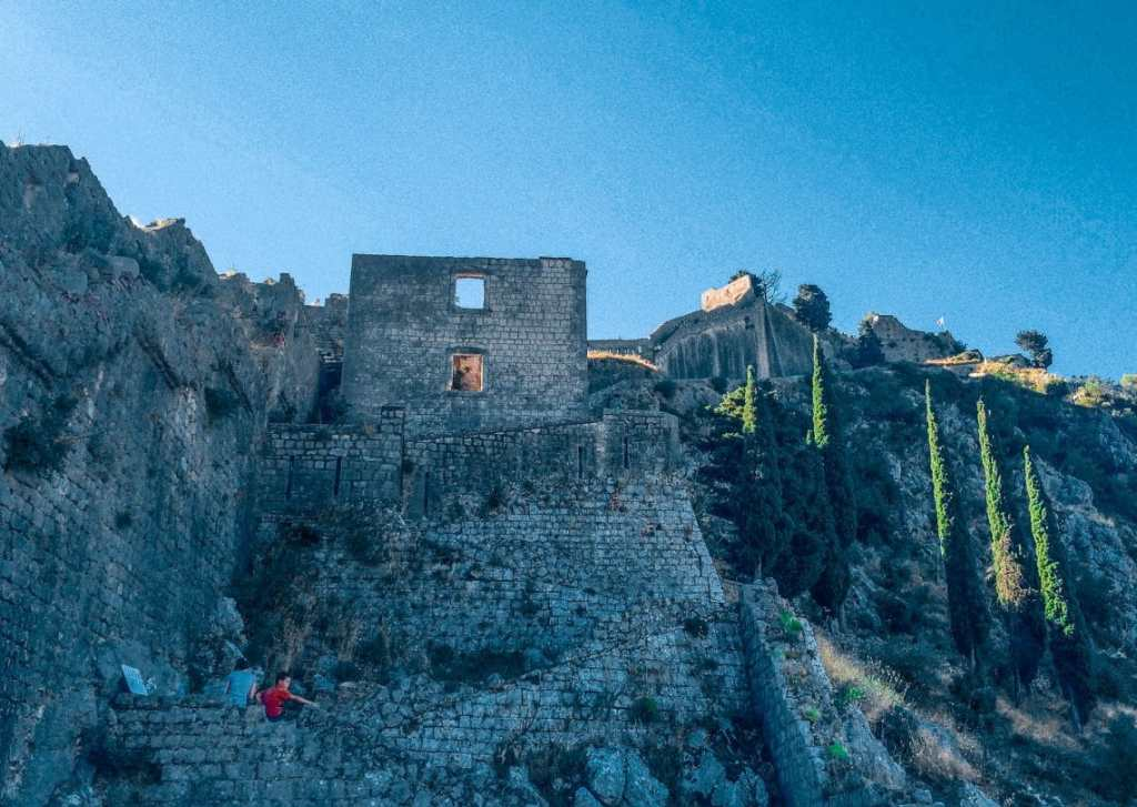 6th century stone walls and stair steps zig-zagging at an incline to Kotor's fortress.