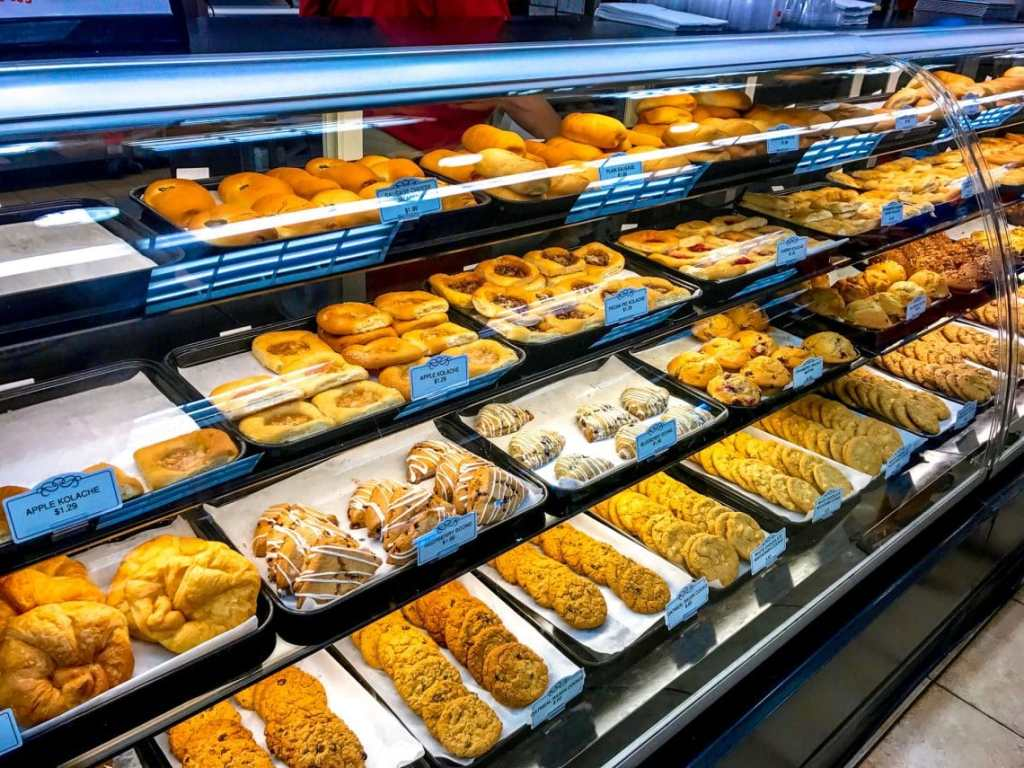 A display case of fresh pastries and danish from Buc-ee's  convenient store in Texas.