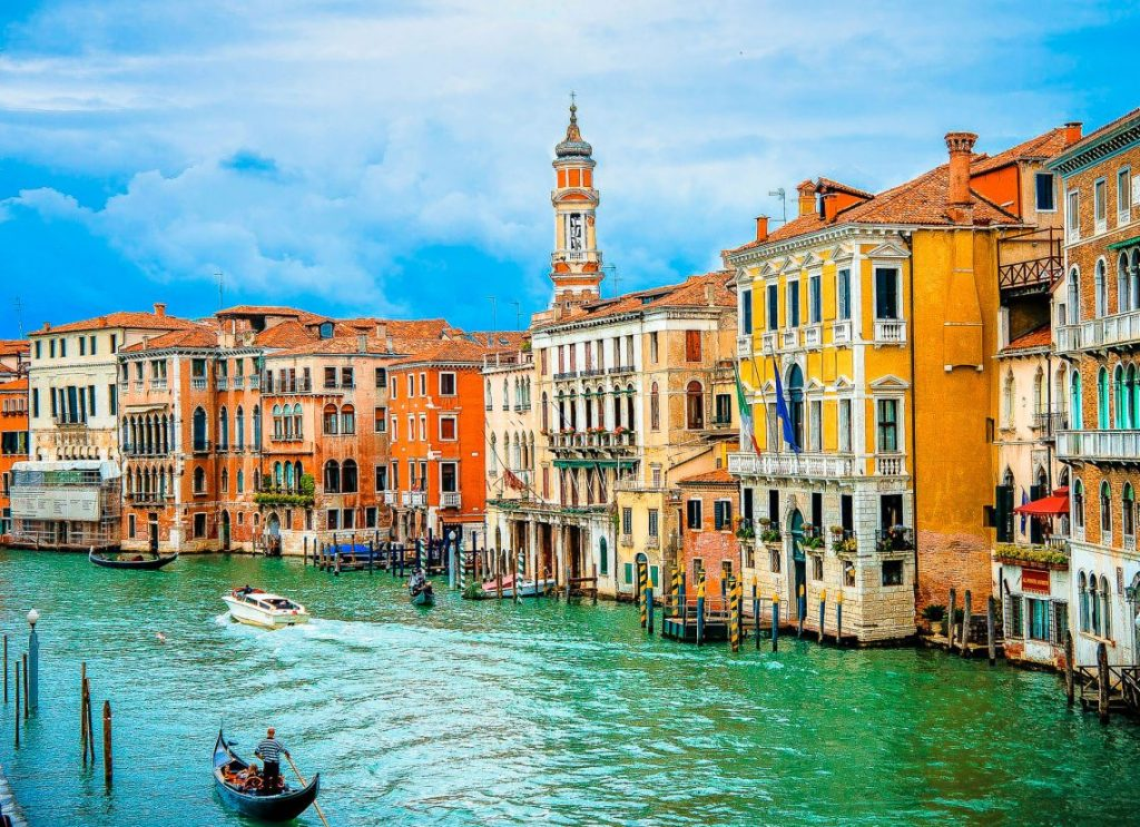 Canal in Venice with colorful buildings along the water.