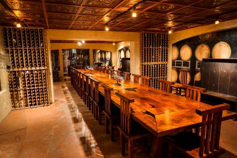 An underground cellar at Becker Vineyards with a long wooden table.
