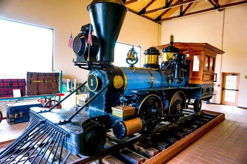 A blue and black locomotive featured in the Brownsville Historical Museum.