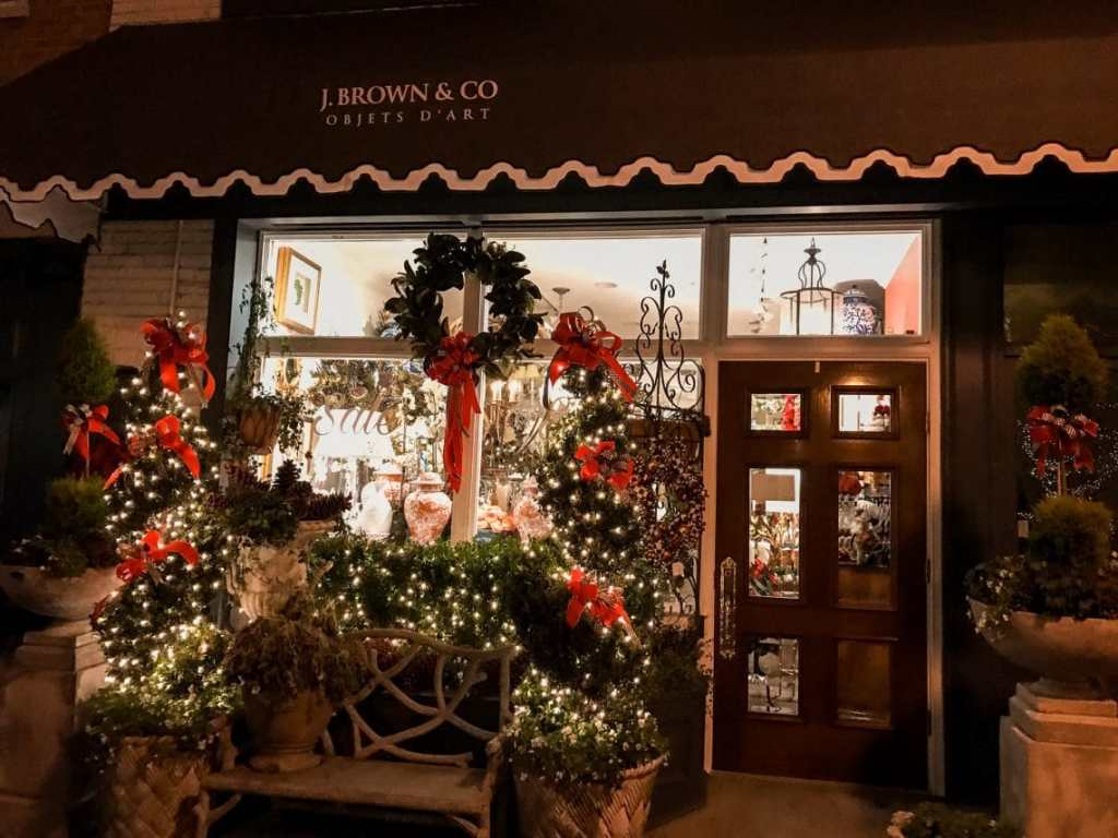 A decorated storefront on Kings Street during the holiday season/