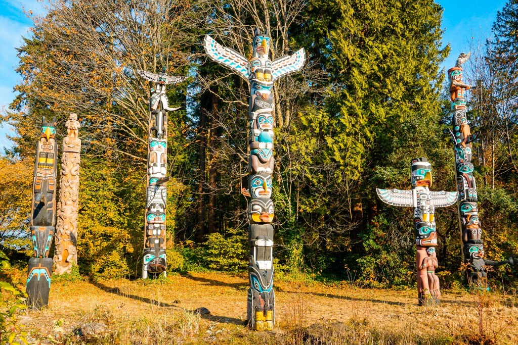 Colorful totem poles in the middle of Stanley Park in Vancouver, Canada.