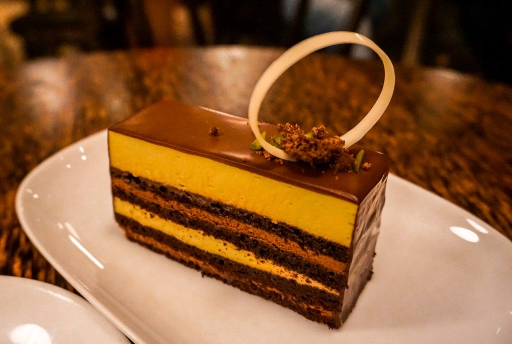 A layered pistachio chocolate mousse cake from Thierry in Vancouver.