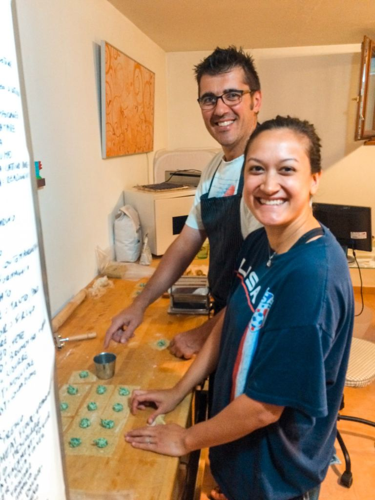 A young woman from the U.S. learning how to cook pasta with her Italian host.
