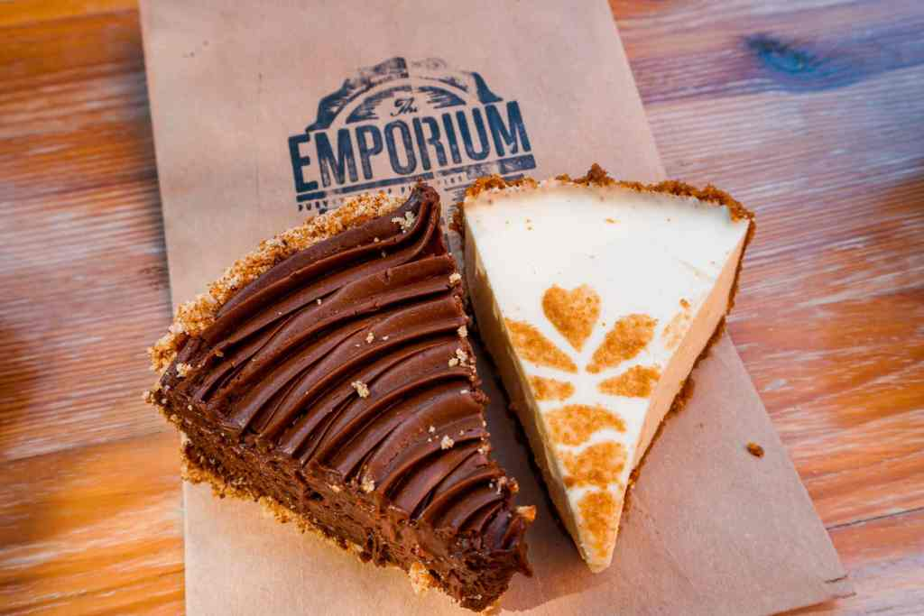 Two beautiful slices of pie from Emporium Pies. Pictured on the left is a chocolate pie and on the right is a lemon chiffon pie.