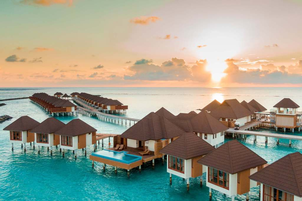 Overwater bungalows in the Maldives, one of the most beautiful babymoon destinations.