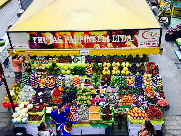 Colourful fruit stall on ground floor of Mercado Municipal