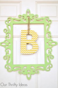 Hang your initial from some twine in the middle of a shaped frame and use it instead of a wreath on your front door | www.OurThriftyIdeas.com #wreath #spring