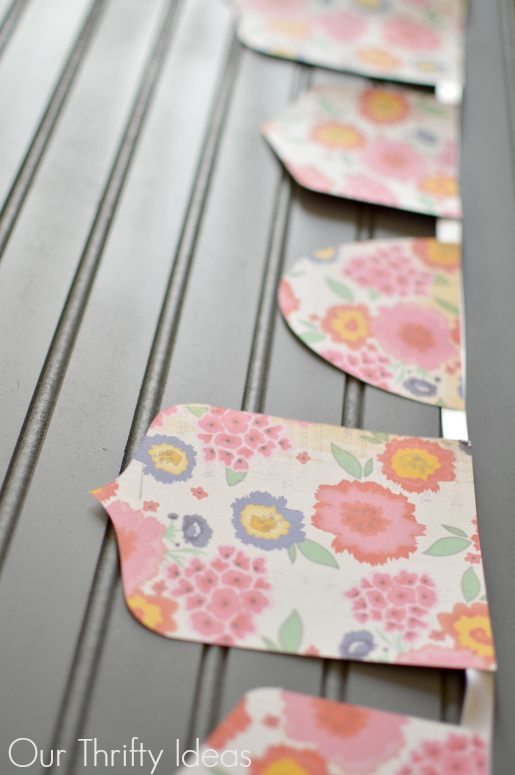 Create this floral spring banner in just minutes, and you probably have all the supplies around your house already | www.ourthriftyideas.com #banner #spring #tutorial