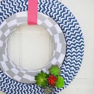 Such a darling wreath made with strips of fabric. And I love the touch of succulents