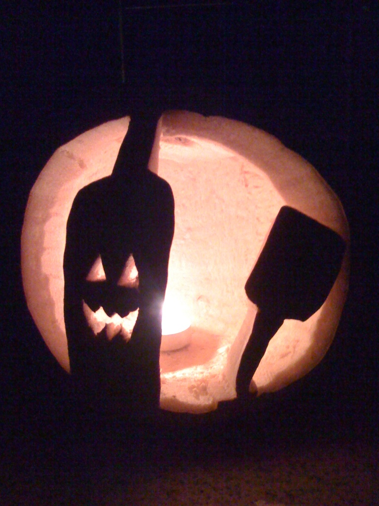 Wine bottle and glass pumpkin.