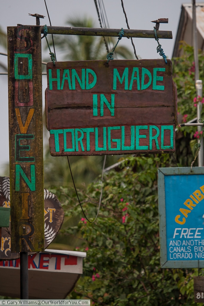 A small sign declaring 'Hand Made in Tortuguero'. I guess it's a gift shop.
