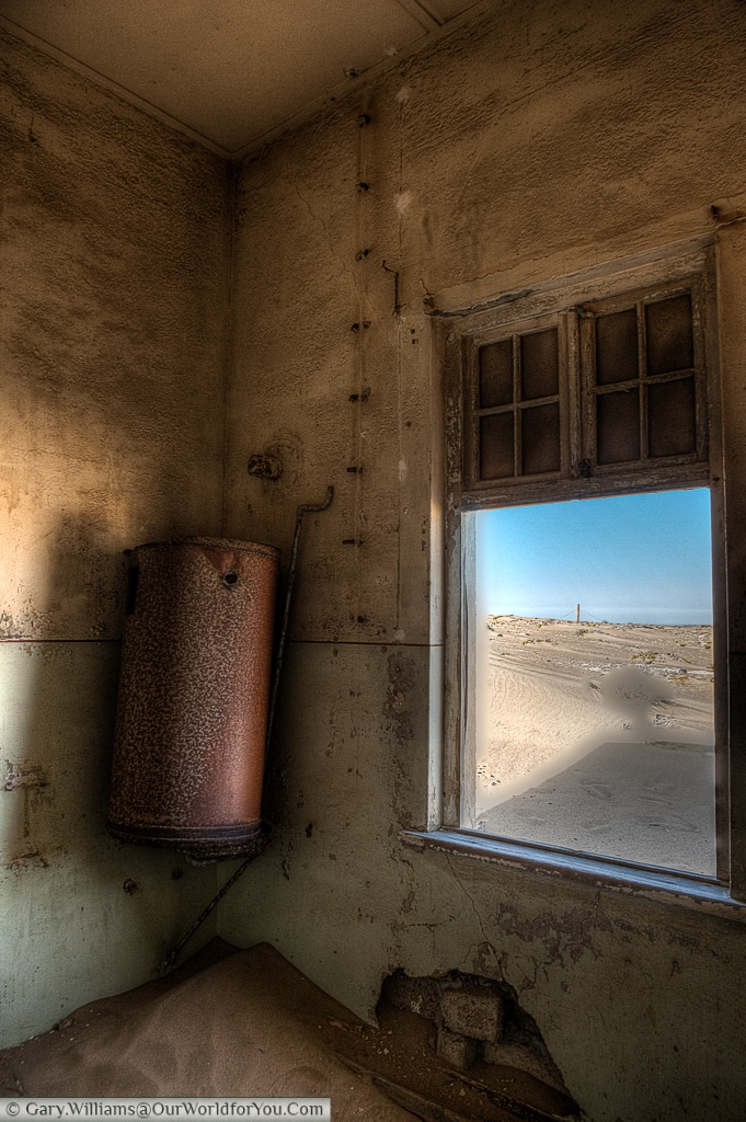 This water tank sits in a now defunct bathroom, Kolmanskop, Namibia