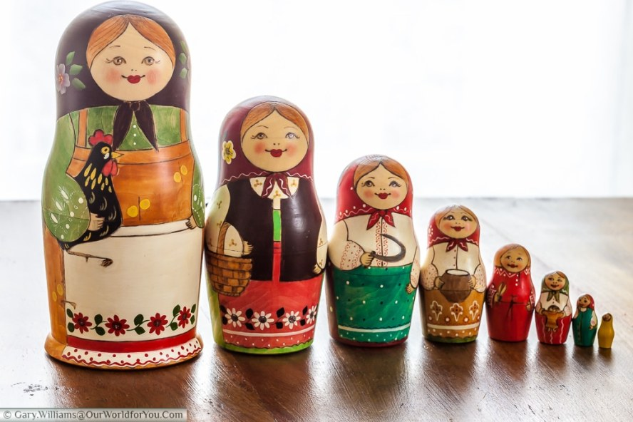The Matryoshka Dolls lined up from tallest to smallest, left to right.