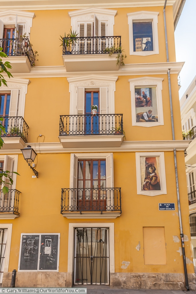 Art in the extra windows in Plaça de Sant Nicolau, Valencia, Spain