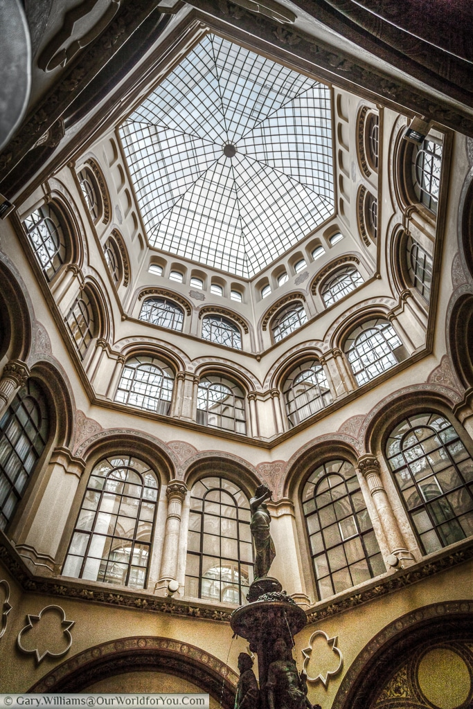 The dome above the Donaunixen in the Freyung Passage , Vienna, Austria